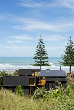 Black, corrugated metal provides the chief construction material for Irving Smith Architects' offSET Shed House, on New Zealand's North Island, where high-level windows maximise northern light in winter