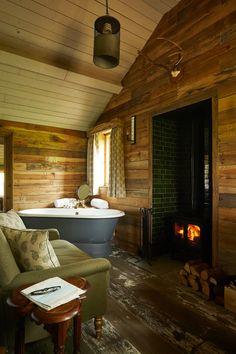 Featuring a Charnwood Island stove Devon Hotels, The Pig Hotel, Rustic Wooden Table, Hall Bathroom, Bathrooms, Vintage Crockery, Cosy Room, Rustic Fireplaces, Wood Fired Oven