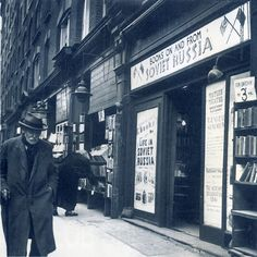 A radical literature bookshop on Charing Cross Road which sells pamphlets about Soviet Russia. Photograph by Hans Wild. Vintage London, Old London, Catherine The Great, London History, Oxford Street, Layout, London Life, Street Photography, White Photography