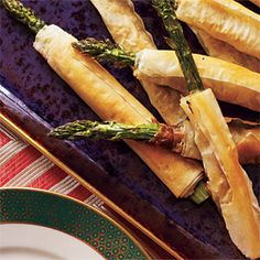 Phyllo-Wrapped Asparagus with Prosciutto  Cooking Light. These are perfection. 3 for 60 calories and SO delicious.