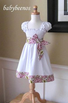Little Girl dress sewing-projects. No link, but really cool and easy dress idea with pre-smocked/gathered fabrics that they have out now, just add poof sleeves and a contrasting tie and hem band.