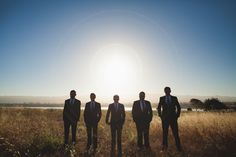 Groomsmen portrait in a field just after sunrise - wedding in Berkeley, CA.  Image by The Rasers.