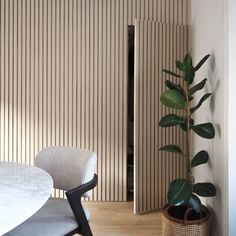 To make use of a wasted space under the stairs, we came up with this modern panelled wall design with a hidden storage cupboard using MDF. Hidden Doors In Walls, Hidden Rooms, Interior Walls, Home Interior Design, Stair Storage, Hidden Storage, Wood Slat Wall, Wood Wall Paneling, Timber Battens