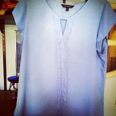Express polyester blouse with lace detail running up the middle. Color is heron blue (a very light periwinkle)
