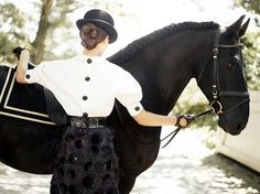 Things equestrians would never do, demonstrated by models: Mount from the right side, in a skirt.