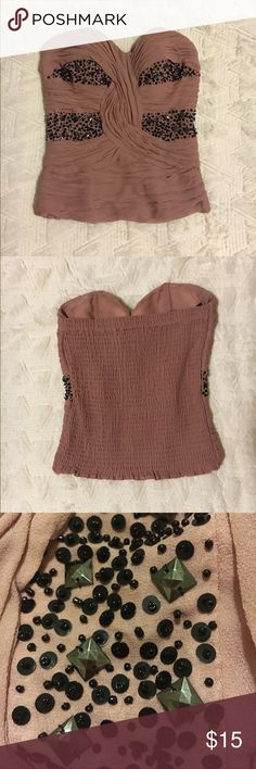 """Bebe dusty rose beaded bustier Beautiful, beaded strapless BEBE bustier in dusty rose pink. Has """"sticky"""" liner around top to keep it in place. bebe Tops"""