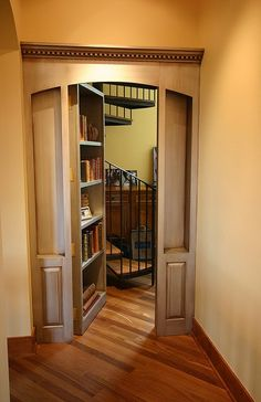 Secret Door to Spiral Staircase Room, Minnesota. I have always wanted secret passages! This one is really neat! Bookcase Door, Bookcases, Revolving Bookcase, Hidden Spaces, Hidden Rooms In Houses, Secret Rooms, Secret Space, My New Room, Home Interior