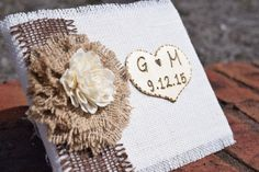 "This listing includes (1) burlap wedding guest book. Guest book measures approximately 8 1/4"" x 6 1/4"". There are 50 double sided pages and 6 lines per page for guest names and addresses (600 lines to"