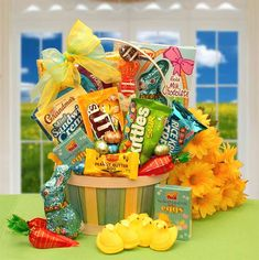 """This Sweets 'N Treats Easter Basket combines some of the yummiest Easter goodies out there! For kids and adults alike, this Easter basket includes:  Peanut M and M candies Tropical Skittles Grandma's cream filled cookies Malted eggs Rice Krispies Treat Wonka's treats candies Easter marshmallow Peeps Mini Reese's Easter egg 6 foil wrapped milk chocolate Easter eggs Mini carrot with jelly beans 8"""" jelly and marshmallow Easter scene sucker Solid Milk chocolate foil-wrapped bunny"""