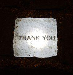 'Thank You' paving stone, Place du Molard, Geneva, Switzerland