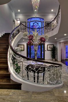 Love the way the photographer captured the staircase with the blue glass behind it.  Gorgeous.
