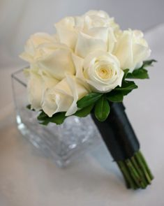 Simple but stylish. I love the green collar and black ribbon around stems.  Google Image Result for http://afloralaffair.com/wedding/bouquets/white_blue/images/BB0506-Simple%2520White%2520and%2520Black%2520Rose%2520Bridal%2520Bouquet.jpg