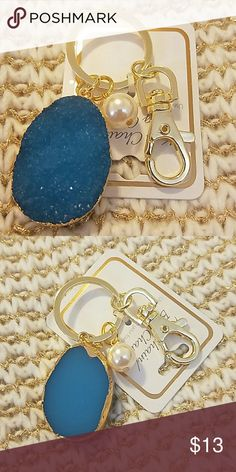 Druzy keychain/bag charm NWT Hand made key chain in gold tone, beautiful blue color paired with pearl charm perfect if you want to glam up your bag for a night out or just keep your keys safe. Laila rowe Accessories Key & Card Holders