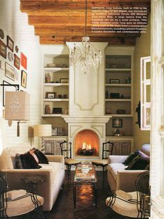 Love the fireplace and shelving! Eight seats in this tiny space! Good use of a narrow coffee table.