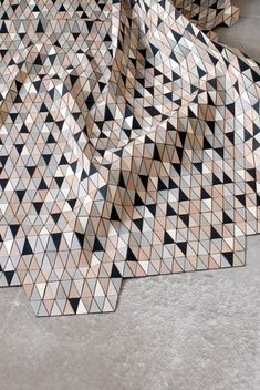 wooden textiles -- a rug made form small wooden triangles affixed to a textile backing. such an array of gorgeous-ness she creates with these.