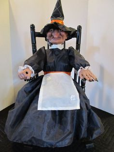 """This is a big Witch in a Rocking Chair. Its a beauty. Made by Gemmy. 22"""" tall and that's sitting. This is from 1991. Requires 3-C batteries or an AC adaptor."""