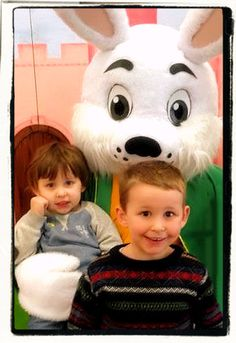 2 little boys getting their choccy treats from White Rabbit at the Mad Hatter's Easter Eggstravaganza with The Party Squad :)   http://www.facebook.com/ThePartySquadUK/ http://www.thepartysquad.co.uk/