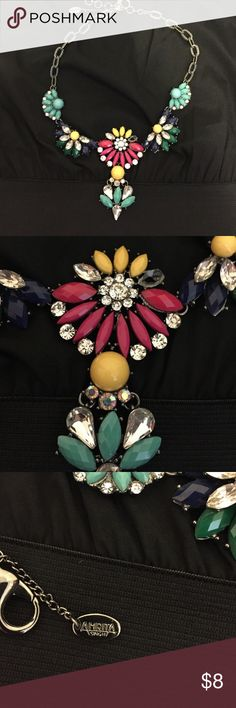 Bold colored necklace Pewter colored chain with mixed material floral accents. One stone is missing, as pictured, but should be easy to replace. All other items in this pic are also available in my closet. Jewelry Necklaces