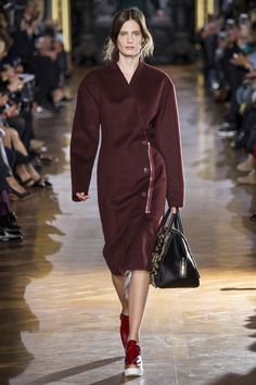 Stella McCartney's Fall/Winter 2014-2015 collection, with ensembles of chunky knits contrasted with sharp tailoring.