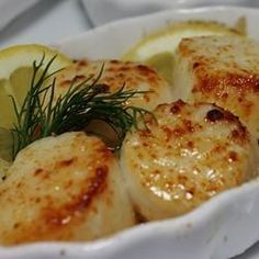 Broiled Scallops Recipe.  Garlic, butter, and lemon juice.  Easy and fast.  Could also top with some parmesan cheese.