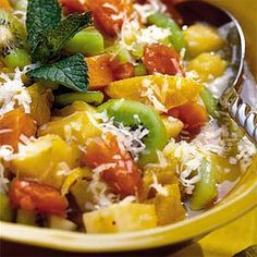 Tropical Fruit Salad ~ Balance your brunch menu with a refreshing and colorful fruit salad of papaya, pineapple, oranges, and kiwifruit. This one is sweetened with honey and topped with coconut, so it's practically dessert.