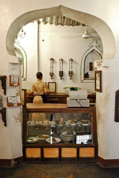 i love the idea of having just a hint of the kitchen exposed and the 'tempting goodies' being a barrier. zanzibar coffee house via apartment therapy and One Third Tribal Cafe Bistro, Cafe Bar, Cafe Restaurant, Saint Germain, Tanzania, Apartment Therapy, Paises Da Africa, East Africa, Zanzibar Hotels