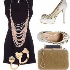 Outfit per la sera, composto da mini dress rigorosamente nero, sandali dal tacco alto con borchie, pochette color oro, e accessori vistosi... Un look sexy e strong, per una donna che vuole osare.
