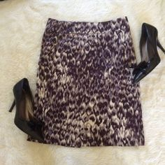 J. Crew Stretch Pencil Skirt    Size 0 Classic J. Crew stretch pencil skirt. Cotton/spandex blend makes this skirt comfortable and sleek. Lilac leopard-ish print. What are those? Feathers? Not sure, but it's cute while being entirely office appropriate. Back vent and zip. Size 0. J. Crew Skirts Pencil