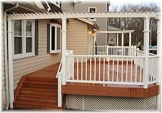 redwood deck with white metal railing   Trex Composite Deck with Monarch White Synthetic Railing
