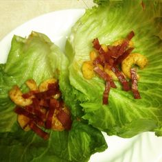 Turkey bacon, shrimp seasoned with creole, black pepper, onion powder, minced garlic, and like juice in a lettuce wrap! Spicy yet satisfying!