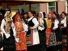 France - The ladies shown are dressed in traditional French clothing, so this picture represents culture.