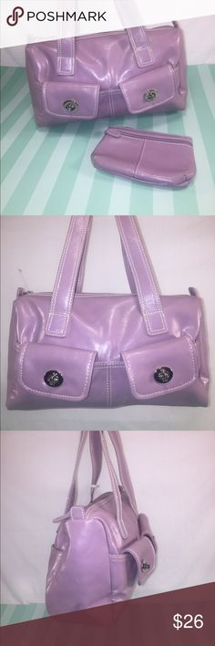 NINE WEST Lilac Satchel & Wallet NINE WEST Lilac Satchel & Wallet. White contrast stitching, Silver tone hardware,2 front turnkey pockets, 2 slip pockets, khaki interior lining, storage for 3 cards,1 see-through ID window,phone pocket,2 pen pockets,keychain clip, &1 large zip pocket. Matching wallet has 1exterior zip pocket, overall zip closure, &mirror on the back. Fits perfectly into bag's interior pocket. All man-made materials. New without tags. Looks nice! Orig. $78. Nine West Bags