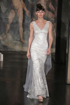 Mermaid sheath of sequin branches, and soft pink and silver beading with tulle Watteau train.