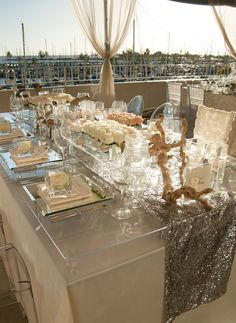 a modern tablescape on a floating table.  platinum sequin runners.