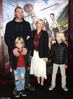 Close: Naomi held her son's Peter's hand while Liev kept a close eye on Sam...