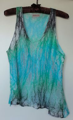 Nuno felted camisole. Very feminine and flowy! Nuno felt is a great place to start...though I think I would start with a scarf.
