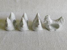 Set of 4 White Ceramic Rooster Napkin Rings. $13.00, via Etsy.