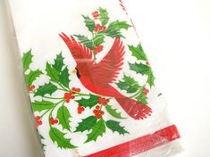 Featuring green holly, red berries and cardinals, this vintage Hallmark Christmas tablecloth will make your next party cleanup a breeze!