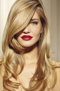 A sleek blowout and soft waves is so glamorous,  especially with red lips...want this hair style volume and color..