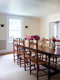 """""""In the dining room, we have a table that can seat twelve and an old hutch,"""" Frances says. """"I like to run vases down the table filled with flowers from the garden."""""""