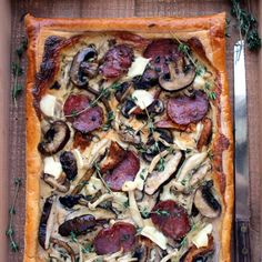 Three cheese, mushroom and saucisson sec (French salami) puff pastry tart. Earthy, sweet, salty, spicy, creamy, crisp and buttery.