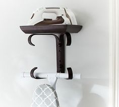 Ironing Board Hanger #potterybarn - This will hold the ironing board and iron when we finish the laundry room