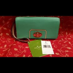 Authentic Kate Spade Turnlock Wallet Brand new with one blemish in the leather on the front of wallet as shown. Hard to see in person without looking for it.  The zoom and lighting magnified it. Aquacove (941) coveted color.  Mara WLRU1598. Please do not buy from me if smoke or pet hair is not your thing. It can creep in unexpectedly even though i take great care when packaging my items. kate spade Bags Wallets