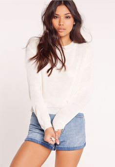 Up your basics and feast your eyes on this fine knitted jumper. Featuring an ever classic white and crew neck style, this is a seasonless piece to seriously up your day game. Match with denim shorts and black ankle boots for a fierce flair....