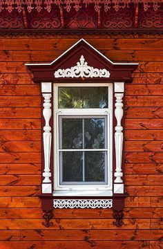Russian wooden house in the old town of Suzdal, window with carved decorations.