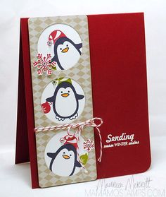 warm winter wishes trio of penguins through circle windows