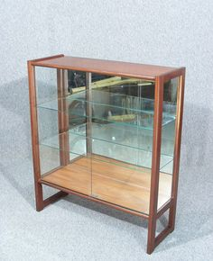 this is a wonderful vintage retro teak display cabinet by turnidge of london double glass sliding doors two removable glass shelves glass sides and mirror