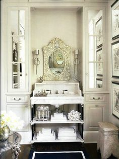 Veranda: Candace Barnes - Elegant, sophisticated marble washstand flanked by mirrored built-in ...