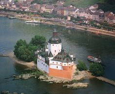 """Pfalzgrafenstein Castle - a toll castle on the Falkenau island, otherwise known as Pfalz Island in the Rhine river near Kaub, Germany;  The keep of this island castle was erected 1326 to 1327 by King Ludwig the Bavarian. Around the tower, a defensive hexagonal wall was built between 1338 to 1340.  Later additions were made in 1607 and 1755.  """"The Pfalz"""" was never conquered or destroyed, withstanding not only wars, but also the natural onslaughts of ice and floods by the river."""