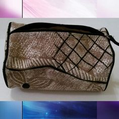 Tan and black makeup travel bag Tan and black makeup travel bag  4in x 4in x 8in  Very good condition minor signs of use  Waterproof lining so no leaks Bags Cosmetic Bags & Cases